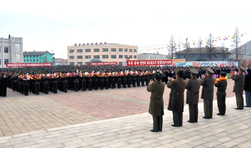 Photo provided by Korean Central News Agency (KCNA) on Nov. 23, 2014 shows servicemen and civilians of the Democratic People's Republic of Korea (DPRK) holding a rally in Kangryong County