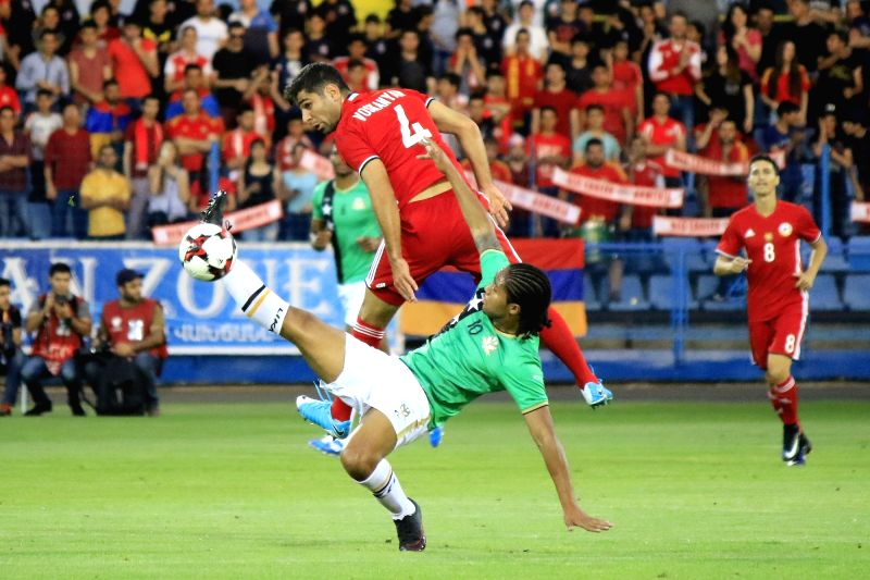 YEREVAN, June 5, 2017 - Armenia's Taron Voskanyan (top) vies with St Kitts and Nevis's Harry Panayiotou (below) during the friendly match between Armenia and St Kitts and Nevis in Yerevan, Armenia, ...