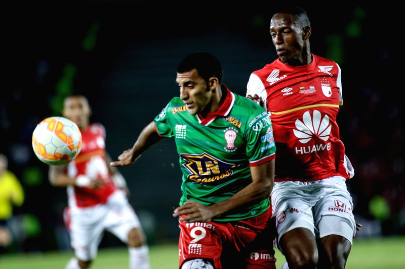 Yerry Mina (R) of Independiente Santa Fe of Colombia vies with Ramon Avila of Huracan of Argentina during the South American Cup second leg final in Bogota, ...