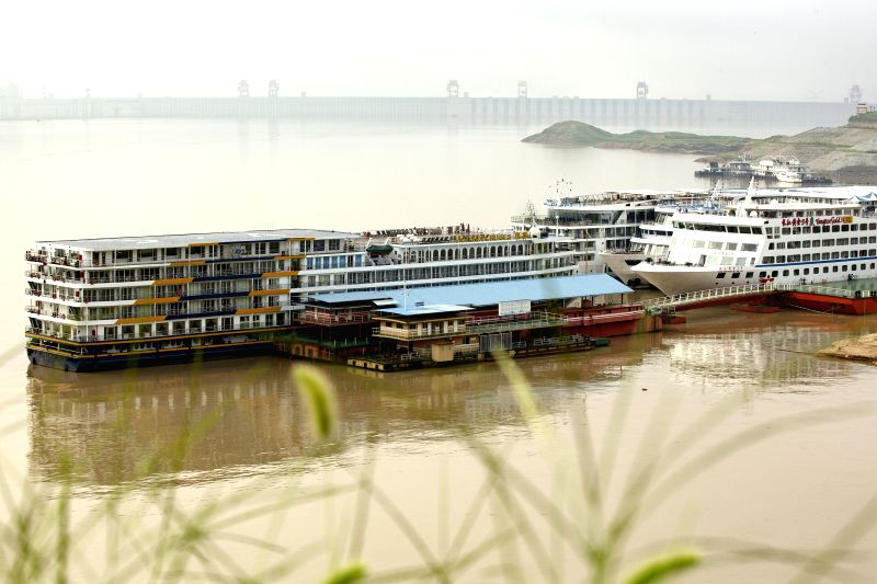 YICHANG, July 15, 2018 - Vessels are anchored nearby the Three Gorges Dam, a gigantic hydropower project on the Yangtze River, in Zigui County of Yichang City, central China's Hubei Province, July ...