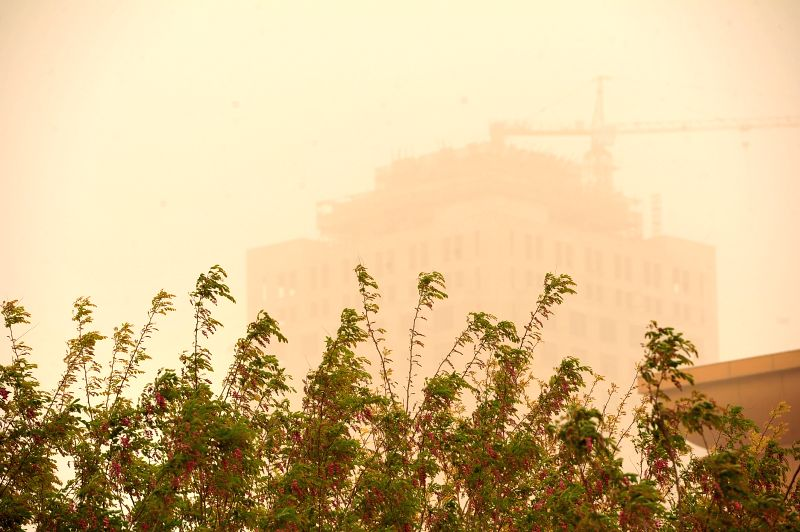 Photo taken on April 24, 2014 shows buildings in sandstorm in Zhongwei City, northwest China's Ningxia Hui Autonomous Region. Parts of Ningxia was hit by a ...