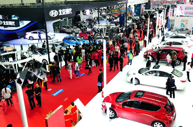 Sedans are displayed at a house and auto expo in Yinchuan, capital of northwest China's Ningxia Hui Autonomous Region, April 29, 2014. A total of 60 car makers ...