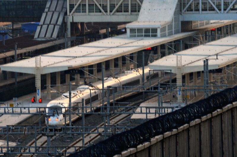 A test high-speed train pulls out of the Yiwu Railway Station during a trial operation of the Hangzhou-Nanchang railroad, a part of the section of the Shanghai-Kunming high-speed railway, in ...