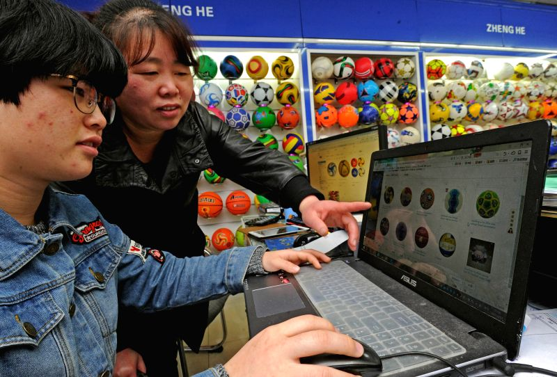 YIWU, April 18, 2017 - Retailer Lu Xiangyi (R) makes business contacts online in Yiwu, east China's Zhejiang Province, April 13, 2017. Online retail sales in Zhejiang reached 213.4 billion yuan (31 ...