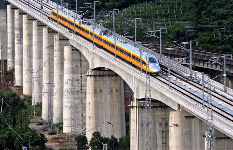 A bullet train runs for test in the Yiwu section of  Hangzhou-Changsha high-speed railway in Yiwu City, east China's Zhejiang Province, July 31, 2014. The 933-kilometer