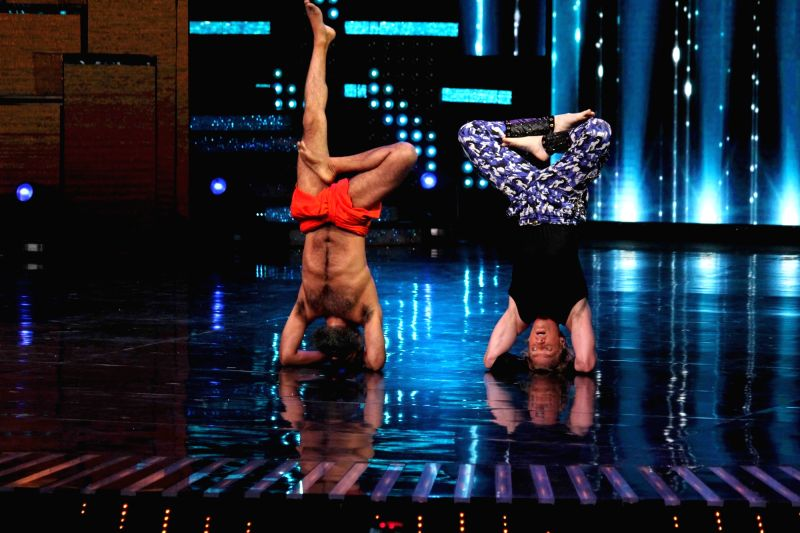 Yoga guru Baba Ramdev with contestant Brent Goble on the sets of Star Plus TV show Nach Baliye Season 8 in Mumbai on May 16, 2017.