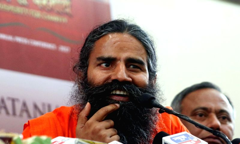 Yoga Guru Ramdev addresses a press conference in New Delhi on May 4, 2017.