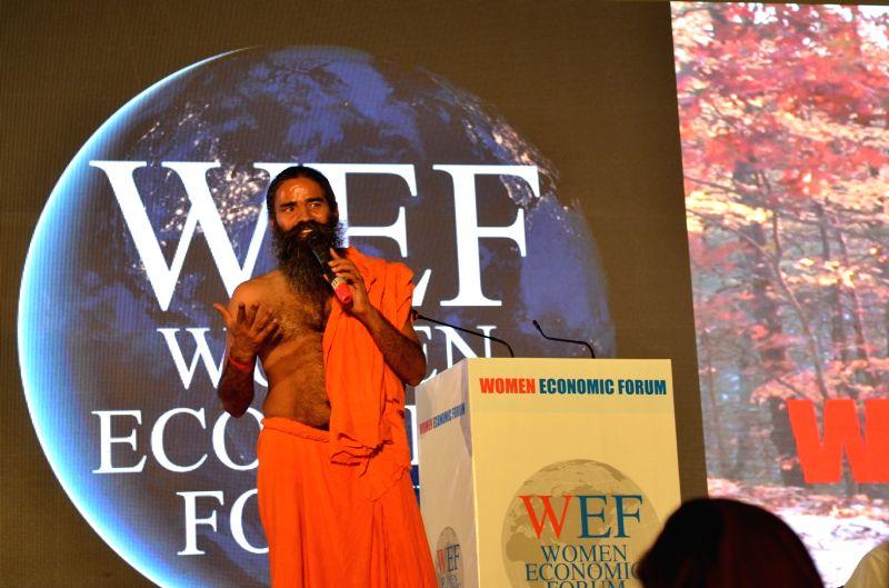 Yoga guru Ramdev addresses delegates at Women Economic Forum-2017 in New Delhi, on May 10, 2017.