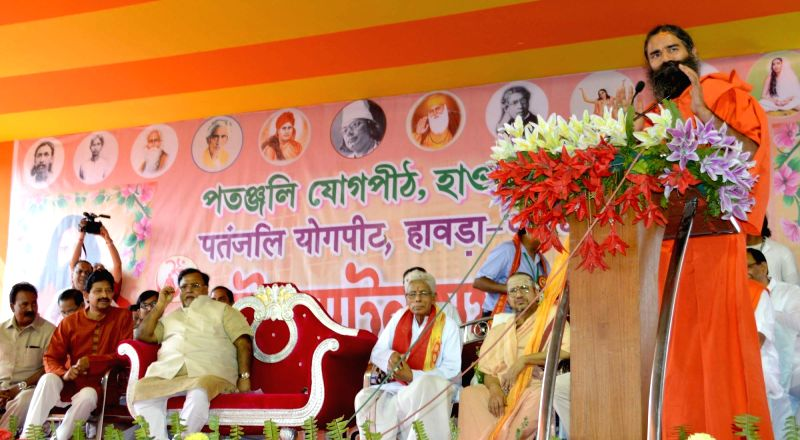 Yoga Guru Ramdev addresses during a programme organised by Patanjali Yogpith in Howrah, West Bengal, on Nov 21, 2015.
