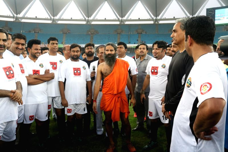 Yoga Guru Ramdev and Members of Parliament during a football match between Bollywood Celebrities and Members of Parliament at Jwahar Lal Nehru Stadium, in New Delhi on July 24, 2016.