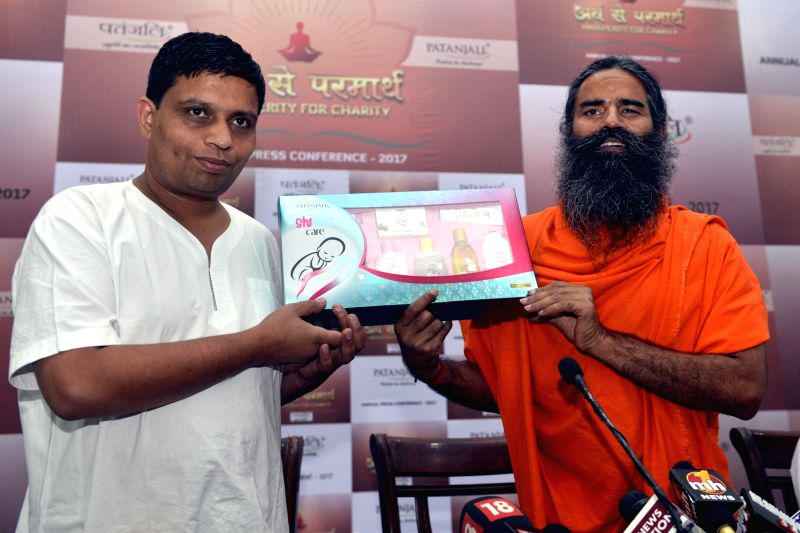 Yoga Guru Ramdev and Patanjali Ayurved MD Balkrishna during a press conference in New Delhi on May 4, 2017.