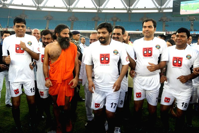 Yoga Guru Ramdev and Union Minister of State for Heavy Industry & Public Enterprises Babul Supriyo during a football match between Bollywood Celebrities and Members of Parliament at ...