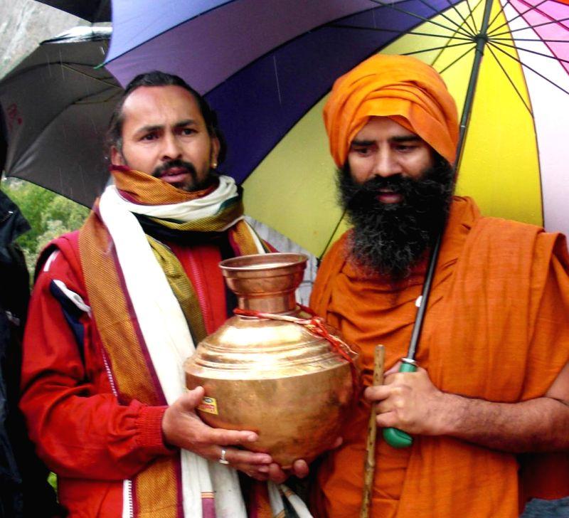 Yoga guru Ramdev during his visit to Uttarkashi of Uttarakhand on July 17, 2014.