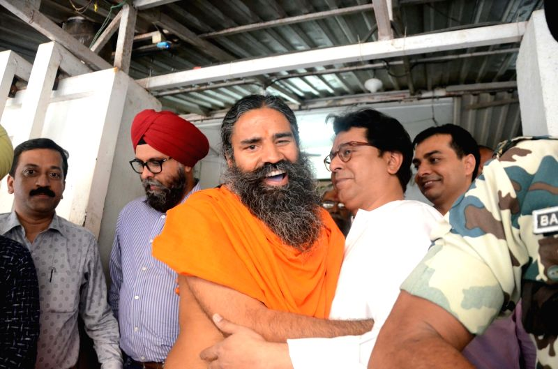 Yoga Guru Ramdev meets Maharashtra Navnirman Sena (MNS) chief Raj Thackeray at his residence in Mumbai on May 17, 2017.