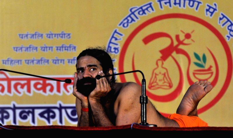 Yoga Guru Ramdev performs Yoga at a camp in Kolkata, on Nov 19, 2015.