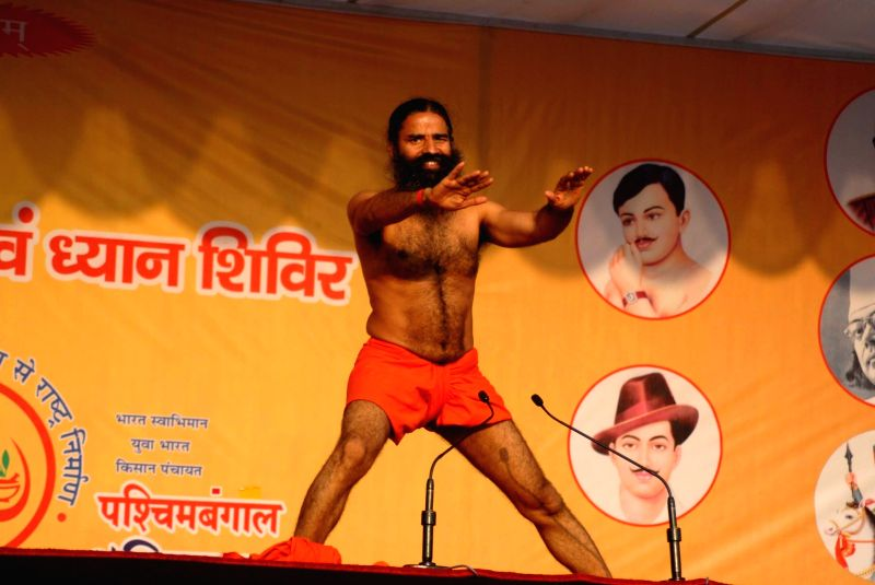Yoga Guru Ramdev performs Yoga at a camp in Kolkata, on Nov 21, 2015.