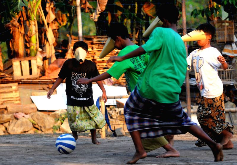 Children play a football match during celebration of 69th independence day of Indonesia in Sleman, Yogyakarta, Indonesia, Aug. 10, 2014. Indonesia will celebrate