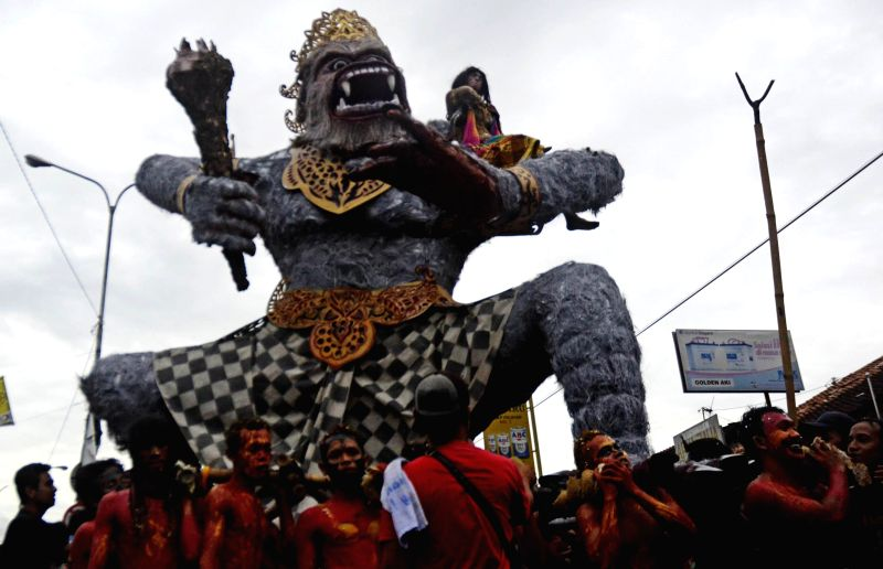 Yogyakarta (Indonesia): People carry a giant puppet during Saparan Bekakak folk carnival which is a form of cultural preservation in Yogyakarta, Indonesia, Dec. 5, 2014.