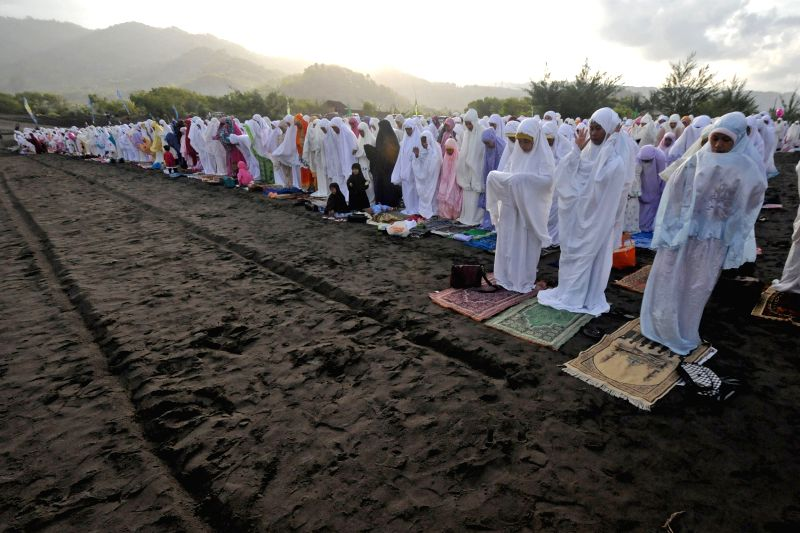 Muslims pray during the Eid Al-Fitr celebration in Yogyakarta, Indonesia, on July 28, 2014. Eid Al-Fitr marks the end of the Muslim fasting month of Ramadan. ...