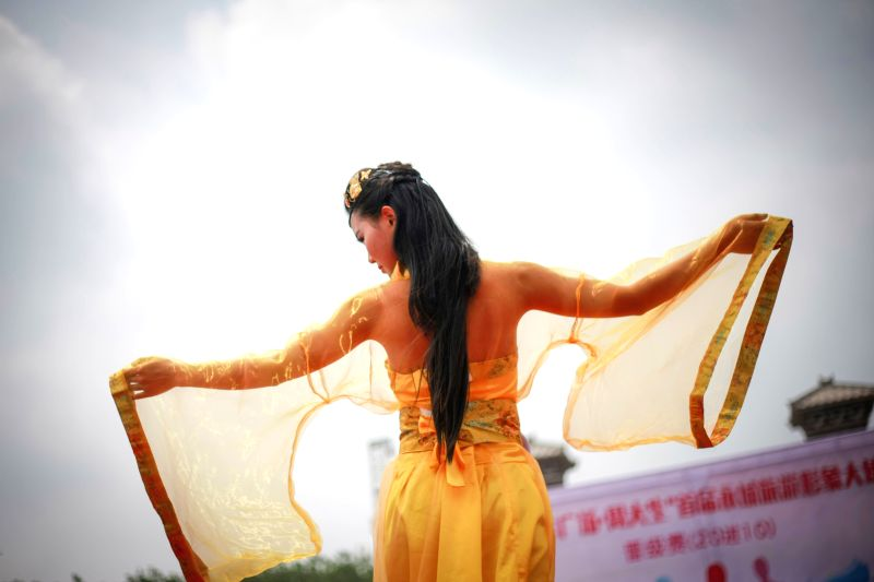 A model displays the Hanfu, or Han dress, in Mang Dang Mountain Han Culture Tourism Area in Yongcheng City of central China's Henan Province, May 2, 2015. Hanfu is ...