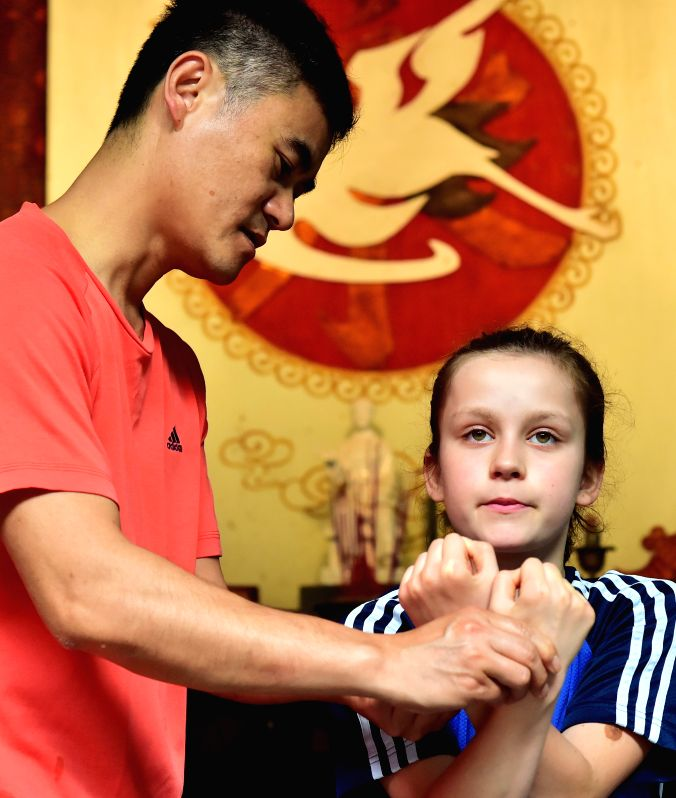 YONGCHUN, April 21, 2017 - Niewerth Luise (R) pracitces at Wenggongci martial art club in Yongchun, southeast China's Fujian Province, April 20, 2017. Influenced by the movie Kung Fu Panda, ... - Bruce Lee