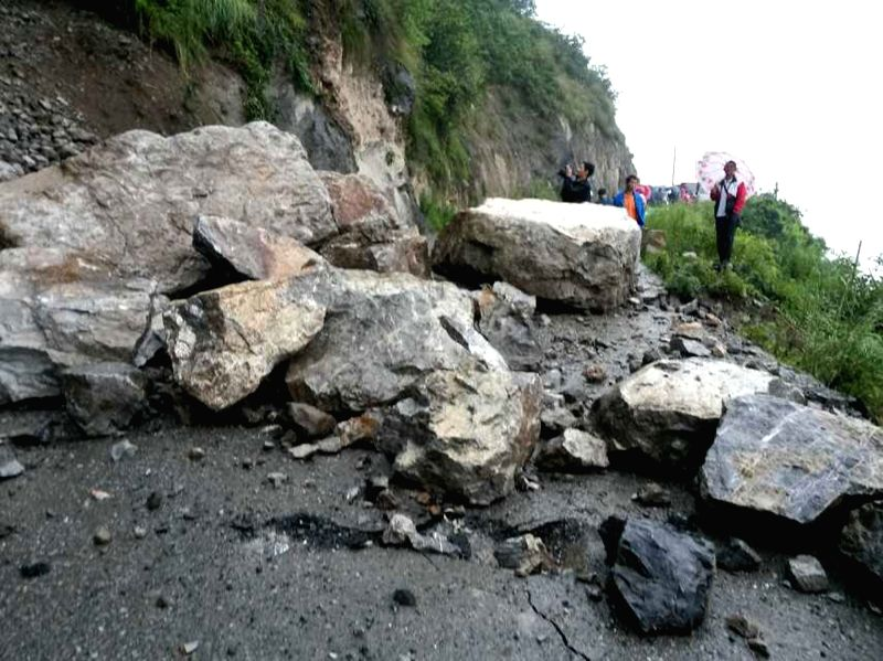 Photo taken on Aug. 17, 2014 shows falling stones block a road leading to the earthquake-hit Yongshan County, southwest China's Yunnan Province. An earthquake ...
