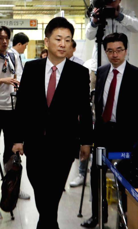 Yoo Young-ha, a lawyer for former President Park Geun-hye, enters a courtroom at the Seoul Central District Court in Seoul on May 2, 2017, for the first trial of Park on alleged bribery. Park ...