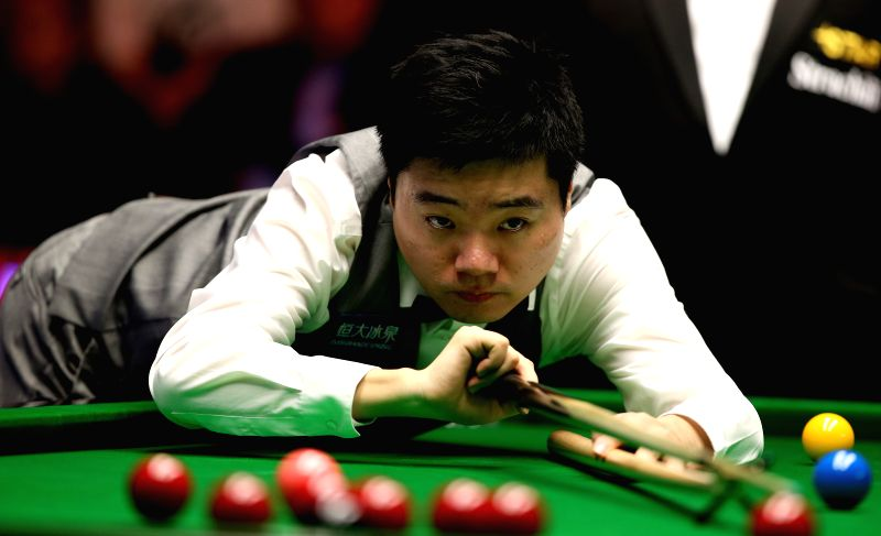 York (England): Ding Junhui of China competes during the Snooker UK Championship 2014 second round match against Jimmy White of England at the York Barbican Center in York, England, on Nov. 29, 2014.