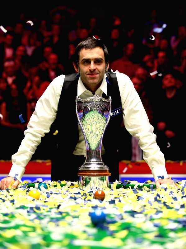 York (England): Ronnie O'Sullivan of England poses with the trophy after the Snooker UK Championship 2014 final against his compatriot Judd Trump at the York Barbican Center in York, England, on Dec.