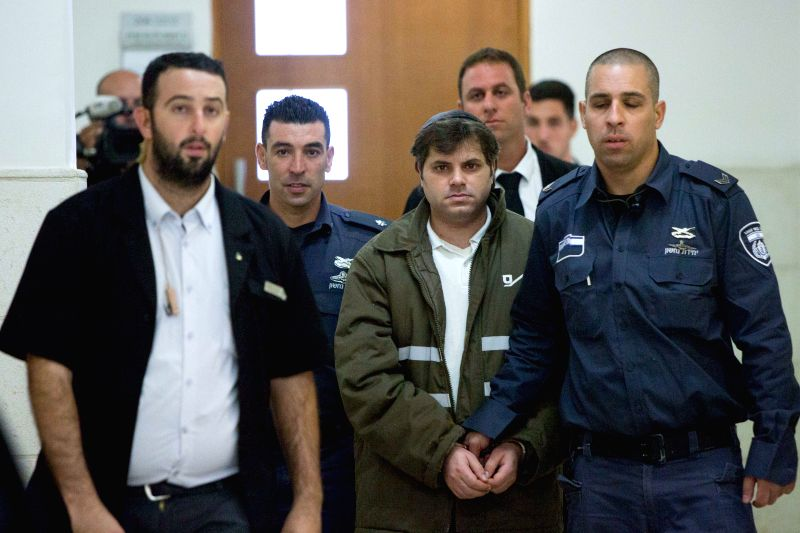 Yosef Haim Ben-David (C), a 30-year-old settler who is the defendant for killing Muhammad Abu Khdeir, is escorted by Israeli police at the Disctrict Court in ...