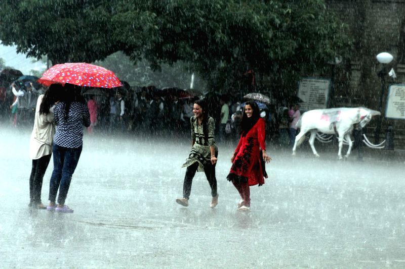 Young girls enjoying themselves as heavy rains in Shimla on June 29, 2015.
