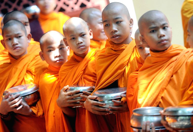 Young monks at Mahabodi Society on 2558th birth anniversary of Lord Buddha in Bangalore on May 14, 2014. Buddha Purnima is the most sacred day in the Buddhist calendar and celebrated on the full-moon