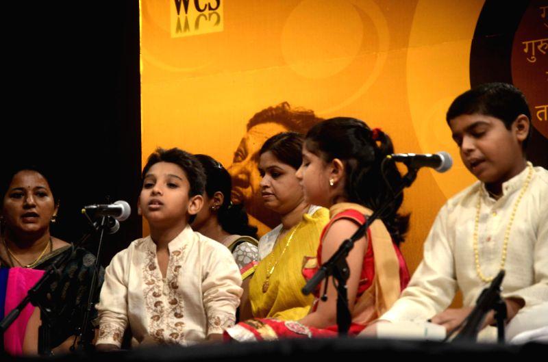 Young musicians perform during a programme organised on Guru Purnima at Veer Savarkar Rashtriya Auditorium in Mumbai on July 13, 2014.