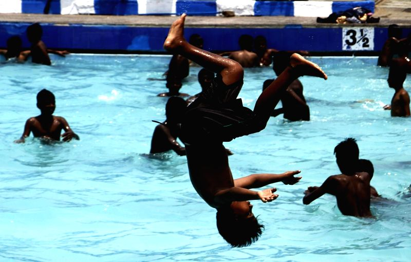 Youngsters beat the scorching heat in Chennai on April 22, 2017.