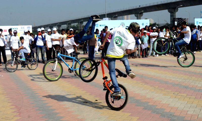 Youngsters display their cycle stunts during a  Smart City campaign in Kolkata, on Nov 22, 2015.