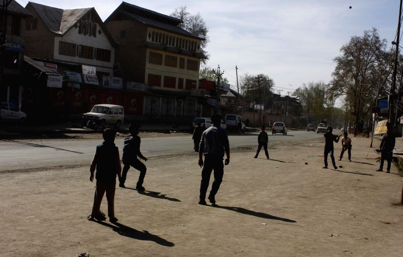 Youngsters play on road as separatist groups call for boycott of 2014 Lok Sabha Elections in Anantnag district of Jammu and Kashmir on April 24, 2014.