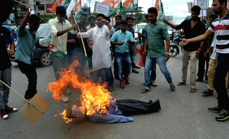 Youth Congress activists burn effigy of  journalist Ved Prakash Vaidik who is in news for meeting 26/11 mastermind Hafiz Saeed during his recent Pakistan visit in Guwahati on July 16, 2014.