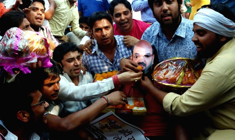 Youth Congress activists celebrate after Harish Rawat government was restored in Uttarakhand; in New Delhi on May 12, 2016.