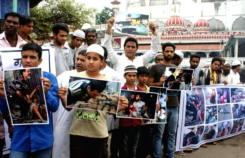 Youth Congress activists demonstrate against Israeli attacks on Gaza in Bhopal on July 21, 2014.