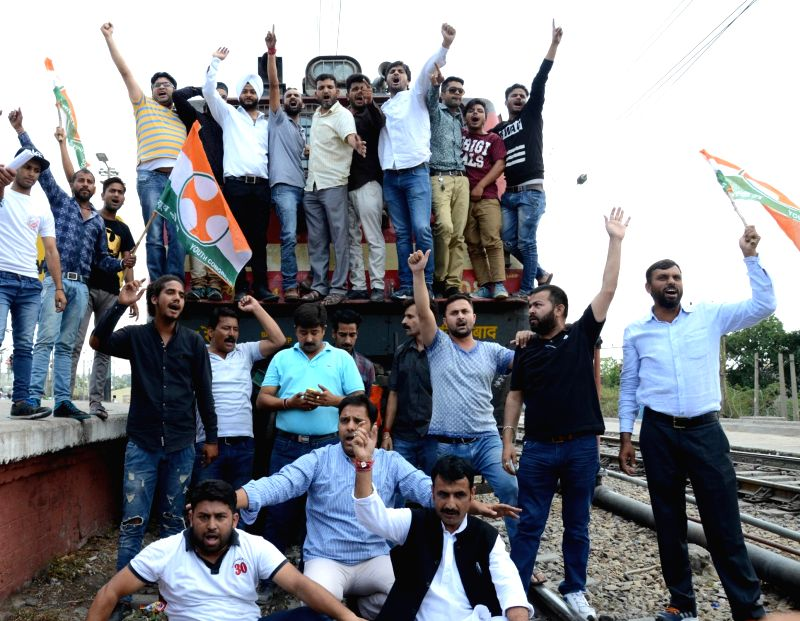 Youth Congress activists disrupt railway services in Jammu against killing of five farmers in Madhya Pradesh's Mandsaur district on June 8, 2017.