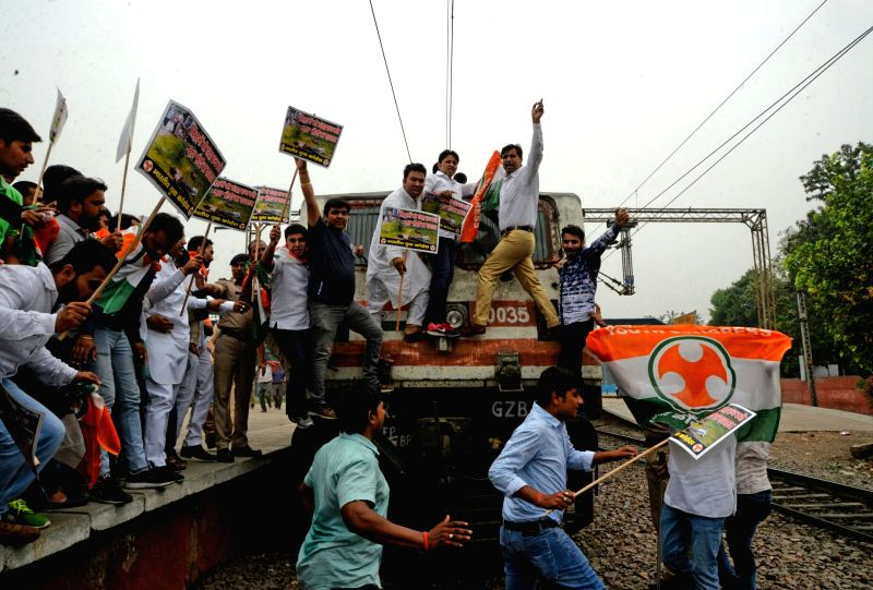 Youth Congress activists disrupt railway services in New Delhi to protest against killing of five farmers in Madhya Pradesh's Mandsaur district, on June 9, 2017.