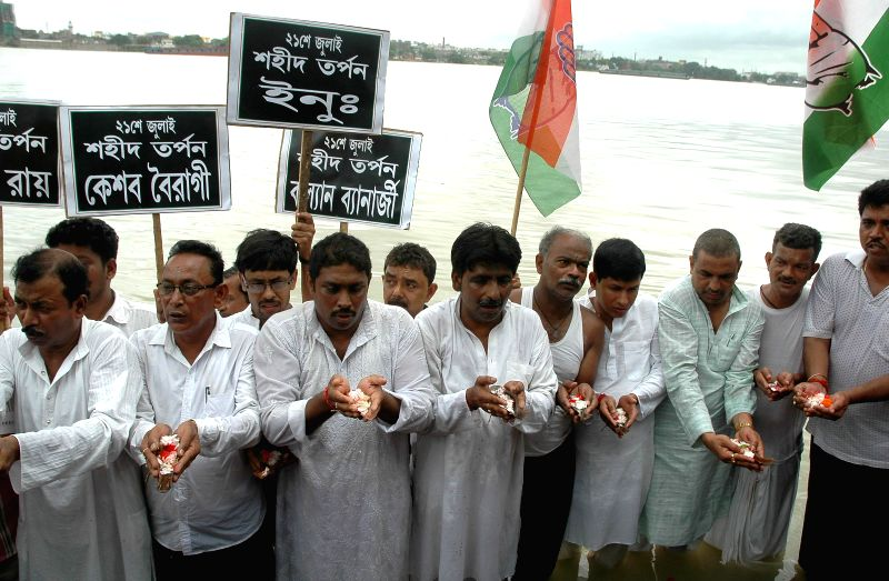 Youth Congress activists pay tribute to 13 Youth Congress workers who were killed in a police firing near Mayo Road on 21st July 1993 in Kolkata, on July 21, 2014.