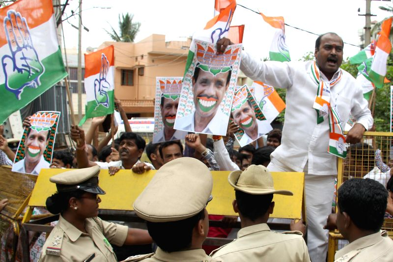 Youth Congress activists protest against BJP leader D.V. Sadananda Gowda's comment regarding Congress Government in Karnataka in Bangalore on May 6, 2014.