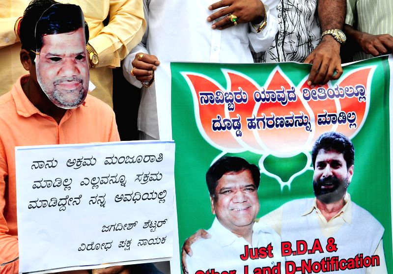 Youth Congress activists stage a demonstration against BJP leader Jagadish Shettar and C. T. Ravi in Bangalore on August 1, 2014.