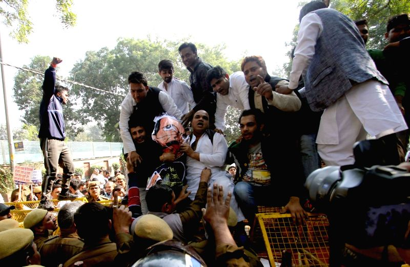 Youth Congress activists stage a demonstration outside the residence Delhi Chief Minister Arvind Kejriwal in New Delhi, on Dec 4, 2015. - Arvind Kejriwal