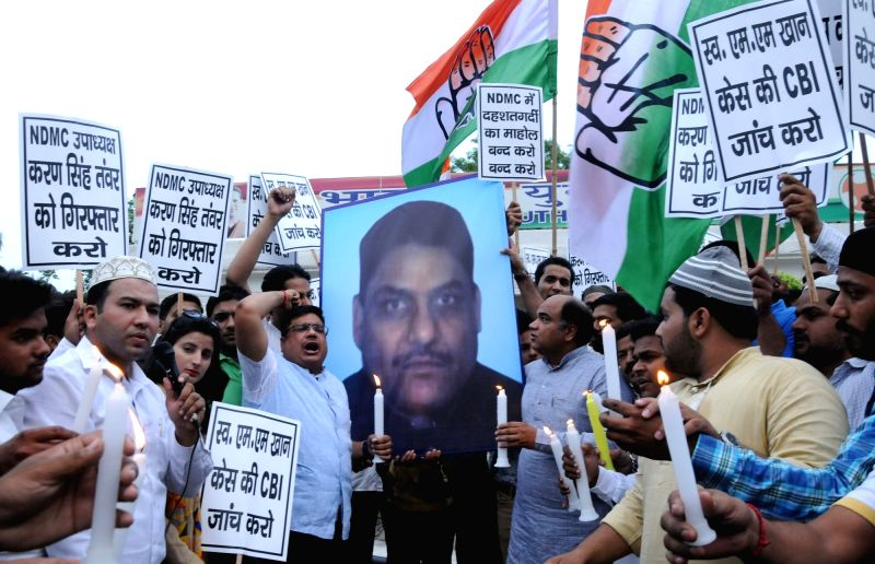 Youth Congress activists stage a demonstration against murder of NDMC Legal Officer MM Khan in New Delhi, on May 29, 2016.