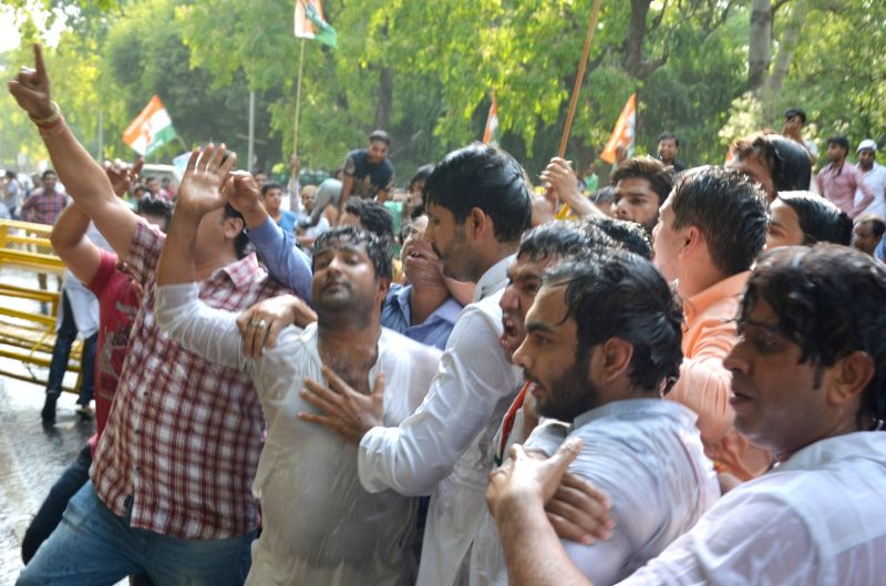 Youth Congress activists stage a demonstration against Union Government in New Delhi on May 26, 2017.