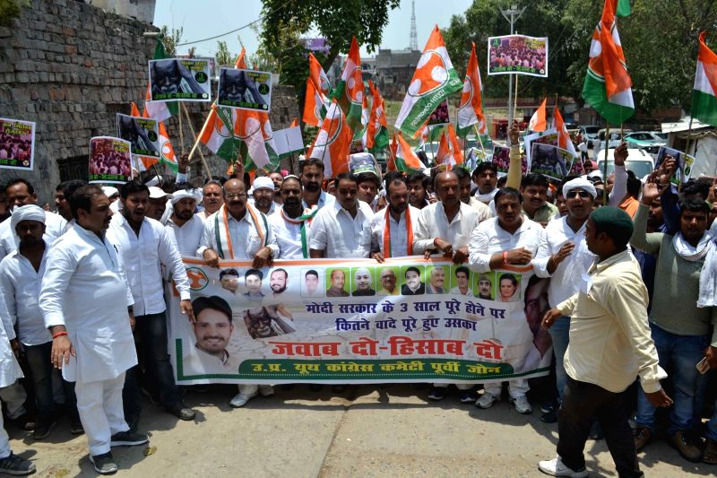 Youth Congress activists stage a demonstration against Union Government in Varanasi on May 26, 2017.