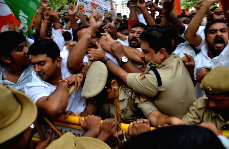 Youth Congress activists stage a demonstration to press for waiving off farmers' loans in front of Union Minister Ananth Kumar's residence in Bengaluru, on July 11, 2017. - Ananth Kumar