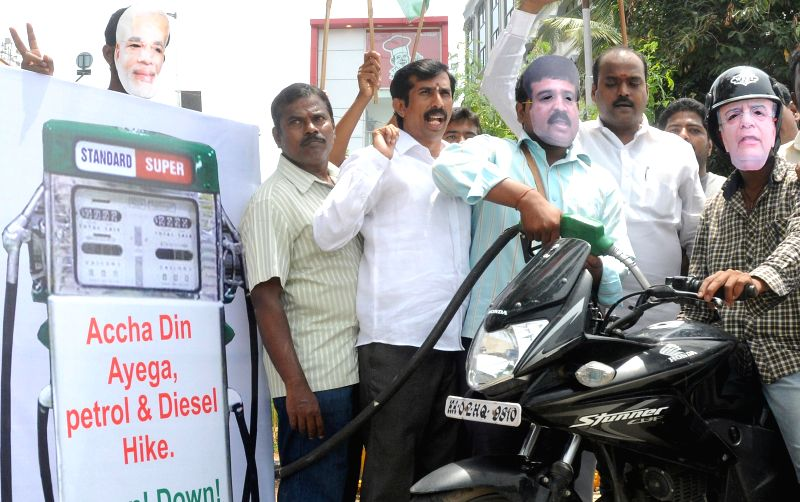 Youth Congress workers demonstrate against hike in fuel prices in Bangalore on July 1, 2014.